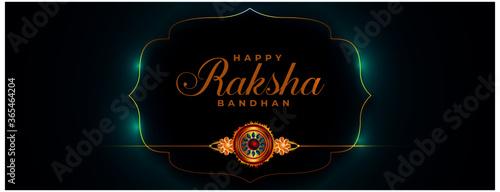 фотография raksha bandhan beautiful banner with golden rakhi