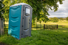 A Plastic Portable Toilet In A Field At An Outdoor Cross Country Horse Trials Event