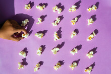 Popcorn Arranged Neatly On A Colorful Background Conceptual Of Obsessive Compulsive Disorder. Pop Art Style