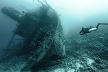 Scuba Diver In The Sea Exploring An Old Wreck