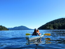A Mother Kayaking With Her You...