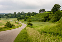 Picturesque Green Landscape View Of Road Winding In Grassy Hills Area. Krasnystaw, Lubelszczyzna, Poland, Europe.