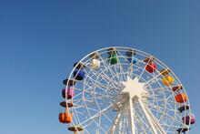 Ferris Wheel On A Blue Sky Sun...