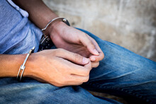 Close Up Prisoner Hands In Han...