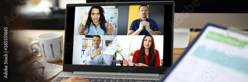 Fototapeta Woman talking with international colleagues using online video chat service obraz