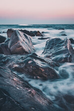 Waves Breaking Over Rocks At T...