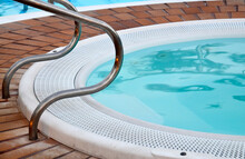 Detail Of Swimming Pool With Stainless Handrails At Tropical Resort. Summer Vacation Or Travel Concept.Selective Focus.