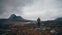 Man Taking Photo Of Mountains ...