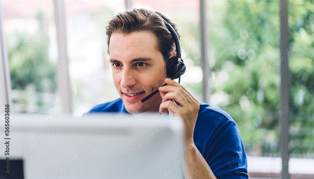 Fototapeta Happy call center smiling businessman operator customer support consult phone services agen working with wireless headset microphone and computer at call center office