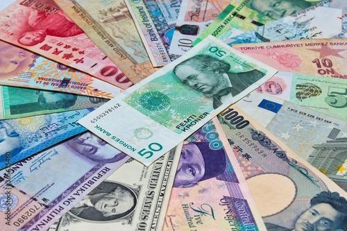 Fotografie, Obraz Norwegian Krone with other world currencies.