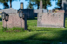 Closeup Of Blank Tombstones With Two Rustic Lanterns At Alatornio Cemetery