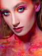 Bright makeup and face art, close-up portrait. Creative makeup,