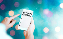 Conceptual Hand Writing Showing Activity. Concept Meaning The Condition Where Many Things Are Happening Or Move Around Modern Gadgets White Screen Under Colorful Bokeh Background