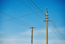 Closeup Of Old Power Poles On A Clear Summer Day.