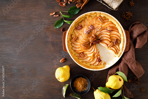 Fototapeta Pear tart, pie or cake with fresh pears, cinnamon and pecan nuts obraz