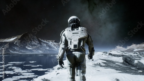 Canvas Print The astronaut is walking on a new unknown snow planet under alien constellations and nebulae