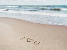 Sea Coast With Soft Surf. Words I LOVE YOU And Heart Symbol Written On Sandy Beach. Vacation On Seaside.