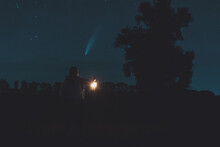 Girl With A Lantern In Her Hand At Night Looking At A Comet Neowise