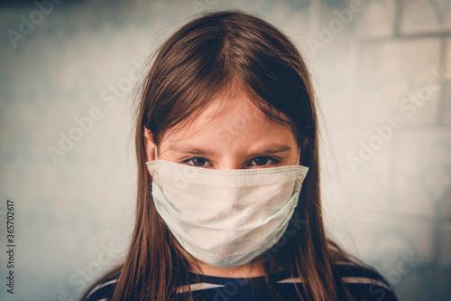 Valokuvatapetti unhappy little girl in a mask
