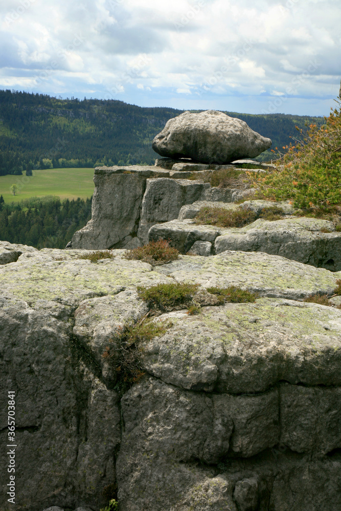 Rock formations in Szczeliniec Wielki in the Stolowe Mountains, the Sudeten range in Poland. The Stolowy Mountains National Park is a great tourist attraction