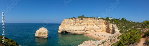 Fototapeta panoramic view to beach in bay at the Algarve coast in Carvoeiro obraz