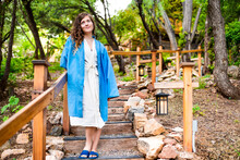 Japan Onsen In Evening With Illuminated Hanging Lantern Lamp Light On Wooden Pole Post In Japanese Garden With Steps Stairs And Woman In Kimono Robe Standing Looking Up