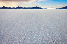 Bonneville Salt Flats Wide Angle View Of Texture At Foreground And Storm Clouds Near Salt Lake City, Utah And Mountain View During Sunset With Nobody Open Landscape