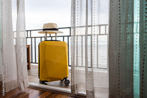Travel suitcase with hat in the bedroom. Wallpaper Mural