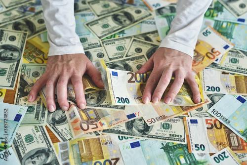 female hands reach for a heap of money Canvas Print