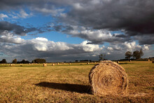 Dark Clouds Over A Sheaf Of Hay In The Meadow.
