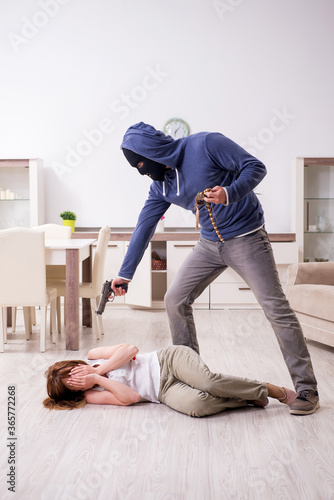Gangster and young woman in robbery concept Canvas Print