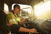 Young Truck Driver Checking The Smartphone At Work
