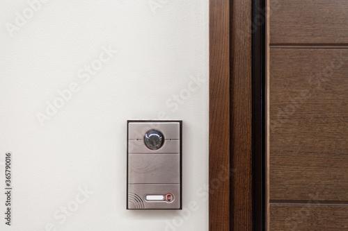 Fototapeta Modern house with contemporary doorbell near door