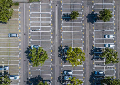 Fotografija Aerial view of large almost empty car parking on sunny summer day
