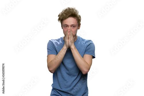 Portrait of extremely sad teenager isolated on white Fototapeta