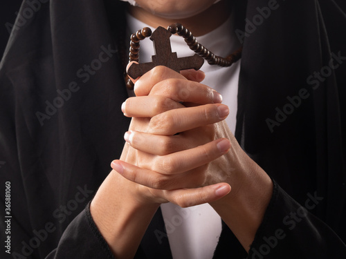 Fotografie, Obraz Close up of Christian, Catholic nun's holding rosary ,cross, in the praying hands