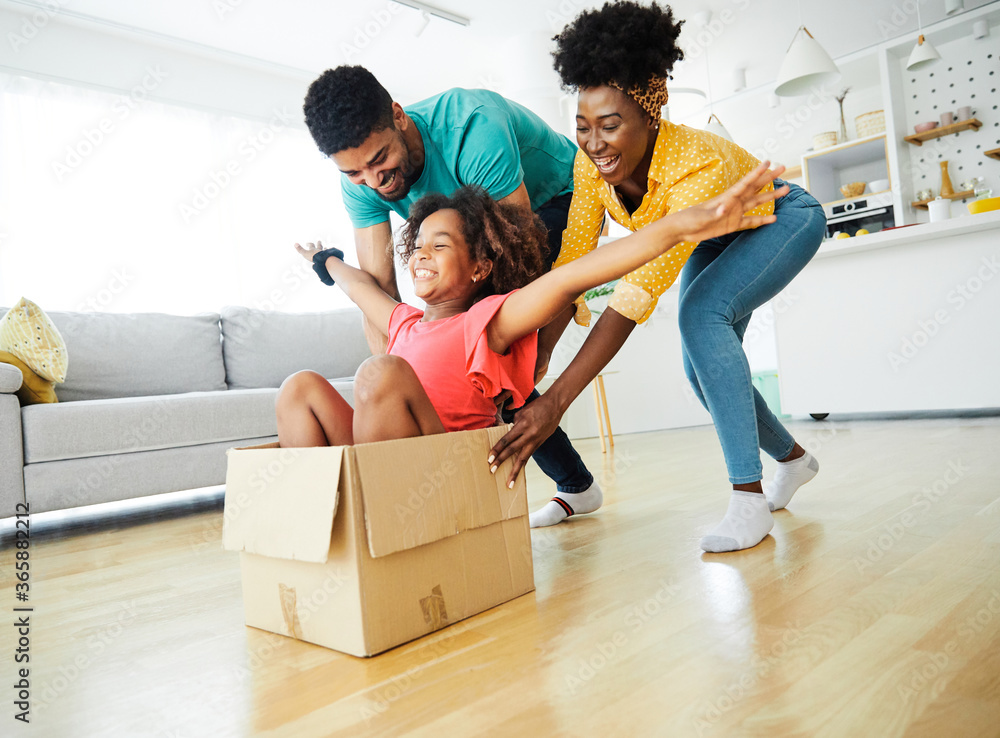 Fototapeta  child family father fun mother happy girl happiness daughter box together relocation moving cardboard box
