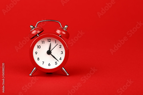Obraz Close up one red alarm clock over red background - fototapety do salonu