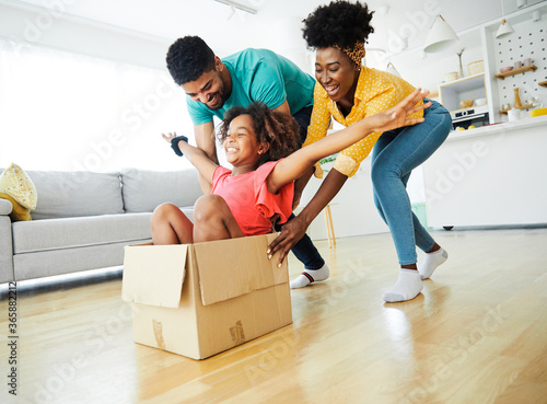 Obraz  child family father fun mother happy girl happiness daughter box together relocation moving cardboard box - fototapety do salonu