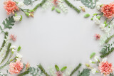 Fototapeta Kawa jest smaczna - White and coral flowers  and silver-green leaves  on pastel grey background. Flowers composition with copy space, flat lay.