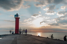 Lighthouse In The Sunset At Th...