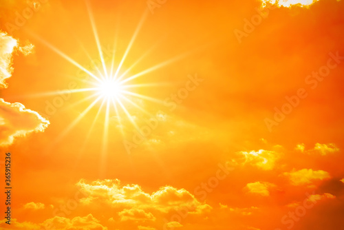 Obraz Hot summer or heat wave background, orange sky with clouds and glowing sun - fototapety do salonu