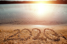 Happy New Year Lettering 2020 On The Beach. Holiday Concept, Vacations.