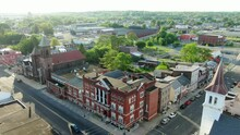 Establishing Aerial Shot Of Colonial Buildings On Street Corner In Lebanon, Pennsylvania, USA, Church And Business Storefronts Along Street