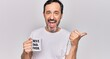 canvas print picture - Middle age handsome man drinking cup of coffee with best dad ever message pointing thumb up to the side smiling happy with open mouth