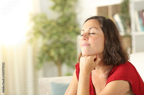 Fotografia Satisfied middle age woman relaxing at home