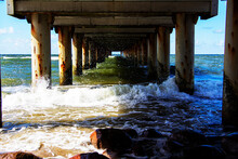 Waves Rumble Under The Pier, A...