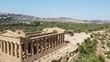 Tourist Destination - Side View Of The Temple Of Concordia In The Valley Of The Temples On A Sunny Day In Agrigento, Sicily, Italy. - aerial drone