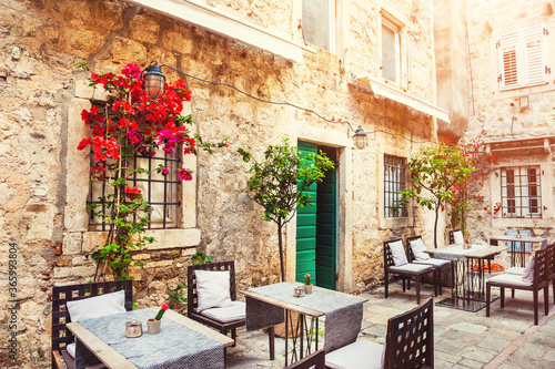 Cafe on the street in Old Town in Kotor, Montenegro. Famous travel destination