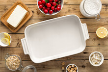 Baking Dish With Ingredients For Cooking Cherry Pie On Wooden Table Top View
